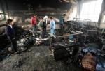 Palestinian children survey damage at school in northern Gaza